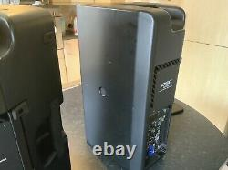 A Pair Of QSC K10.2 Powered Speakers Inc Tote Bags And Mains leads
