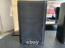 A Pair Of QSC K 8.2 Powered Speakers Inc Tote Bags And Mains leads